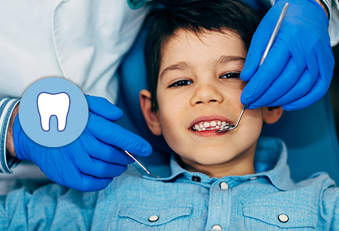 Image of little boy getting dental care