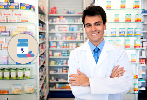 Image of a pharmacist standing in front of a pharmacy