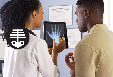 Image of a doctor reviewing xrays with a patient